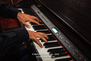 Male Asian Hands on Digital Piano Keyboard