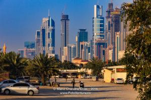 Dubai, UAE - Skyscrapers on Sheikh Zayed Road; Desert Foreground