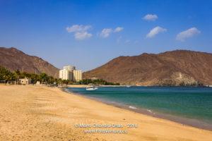 Khor Fakkan, UAE: sandy beach and hotel on Arabian Sea.
