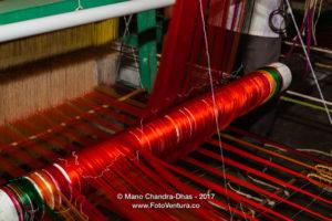 Kanchipuram, India - Silk threads on the loom weaving a sari