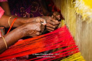 Kanchipuram, India - loading silk thread into hand loom.