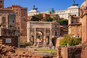 Rome, Italy: Tourists stream through the Arch of Septimius Severus © Mano Chandra Dhas