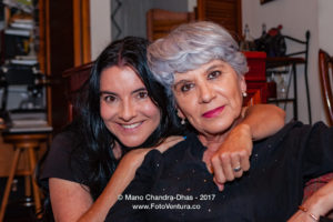 A Senior Hispanic Silver Haired Lady Is Given A Hug By Her Niece