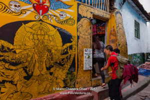 Bogotá, Colombia - Tourists On The Narrow, Colourful Calle Del Embudo