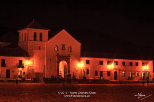 Colombia, South America - Church On The Plaza Mayor Of The Historic 16th Century, Andean Town of Villa de Leyva, In The Boyacá Department After Sunset; Long Exposure, Ambient Lighting.