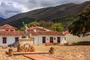 Colombia, South America - The Parque Ricaurte in the Historic 16th Century Andean Town Of Villa de Leyva, With The Statue Of The Martyr In The Centre Of the Square, In The Morning Sunlight