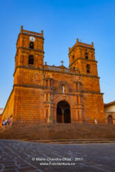 Barichara, Colombia - Tourists At The Historic Cathedral On The 300 Year Old Plaza