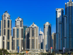 Dubai, UAE: Skyline In Bright Afternoon Sunlight Against A Bright Blue Sky