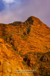 Hout Bay, South Africa: setting sun turns mountain to gold © Mano Chandra Dhas