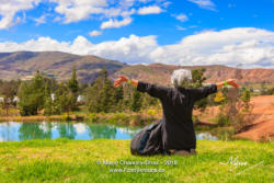 Latin Lady With Silver Hair Celebrates The Beauty Of Nature In the Tranquil Surroundings Of The Pozos Azules Near The Town Of Villa de Leyva On The Andes Mountains In The Colombia Department Of Boyacá