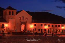 Colombia, South America - Church On The Plaza Mayor Of The Historic 16th Century, Andean Town of Villa de Leyva, In The Boyacá Department At Twilight Time