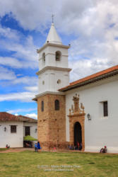 Colombia, South America - The Bell Tower And Steeple Of The Church, Iglesia del Carmen, Of The Carmelite Convent, In The 16th Century Town Of Villa de Leyva, In The Boyacá Department