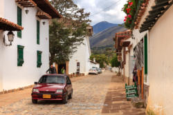 Colombia, South America - Looking At The Cobblestoned Carrera 10 In The Historic 16th Century Town Of Villa de Leyva, Boyacá Department; Background: Andes Mountains